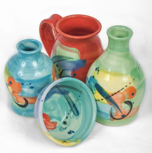 Unique, beautiful, cheerful, and functional handmade pottery. Add some joy to your day!
