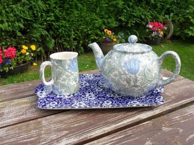 William Morris anemone teapot and milk jug set on a blue victorian calico sandwich plate.