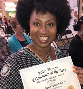"Rev. Karen holding a certificate from the Beacon Newspaper. Her poem, ""Colin Couldn't Stand,"" earned an Honorable Mention from the Beacon during its inaugural arts contest."