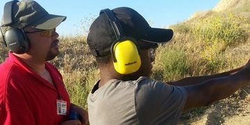Robert working with Issac on pistolcraft