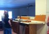 We started this kitchen remodel off by raising the ceiling and opening up the kitchen/dining area to the living room.