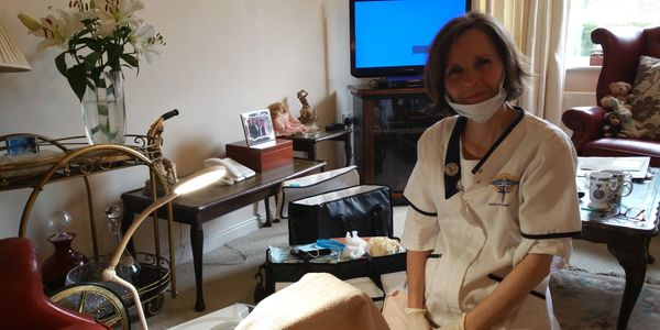Laura Jo doing a home visit to provide foot care in Salisbury