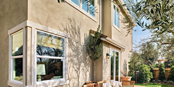 exterior picture of a stucco home with new bayview windows and doors
