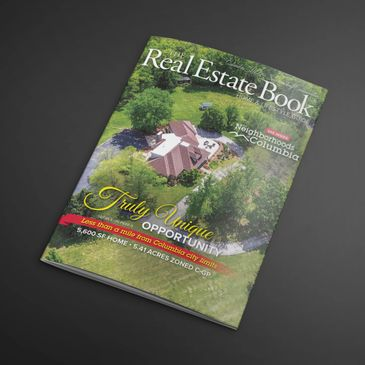 Front cover of The Real Estate Book showing one of the beautiful homes for sale in Columbia, MO