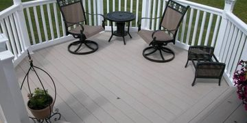 Clay Vinyl deck with White vinyl railing. The color is known as clay or Khaki. Cheap railing.