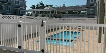 Vinyl fence around a swimming pool.