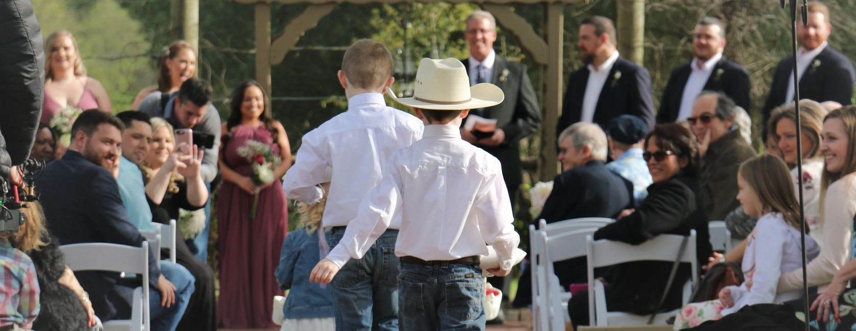 Cowboy flower girl and ring bearer wedding ceremony.