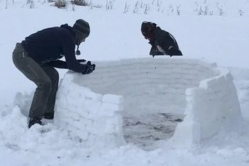 People working on an igloo. Finish your personal history project.