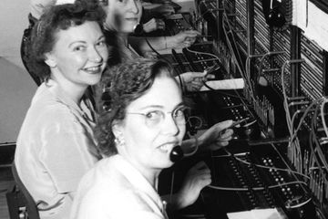 Telephone operators smile for a photo. Leave a legacy recording of your voice telling your memories.