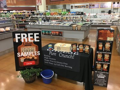 Umland's crunchy cheese demo setup at a Fresh Thyme Farmer's market.