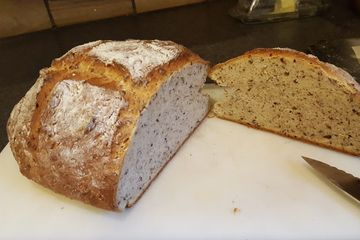 Multigrain sourdough round loaf cut in half