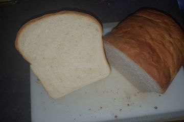 Loaf of white sandwich bread cut in half
