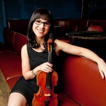 Master Fiddler April Verch plays a Rickenbacker Strad Copy violin. Click link to hear April play.
