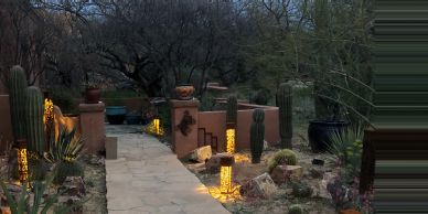 Low-Voltage (12v) Shadow light arrangement of path lights and sculpture highlights.