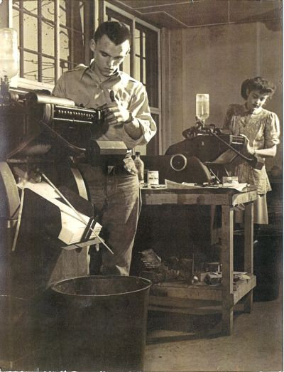 Russell Hatch and Anna Mae Berry in the print shop.