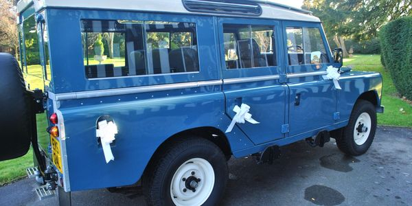 Land Rover Defender with wedding ribbons