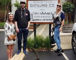 Distillery in Margaret River small group wine tour Group standing next to sign