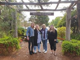 Small Group Wine Tour, 4 ladies standing in front of Happs Winery in Yallingup Margaret River