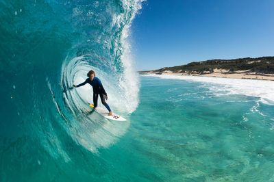 surfer in big barrel wave