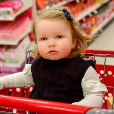 The Original Shopping Cart Vest keeps children safe and secure in the shopping cart.