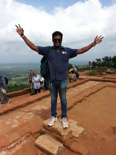 Sanjaya Somarathna , owner operator of Sanjaya Tours Sri Lanka on top of Lions Rock, Sri Lanka
