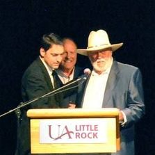 Haymes and Collin Ray present Bob Robbins with the Arkansas CMA award for Radio DJ of the Year.