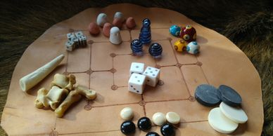 Present Past Historical Crafts - Assorted gaming pieces based on European archaeological finds
