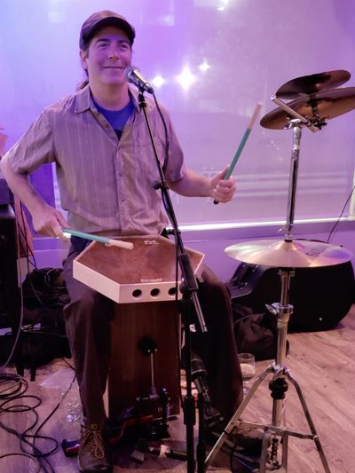 Tim Kelly with his Croaker Cajon and Brush Box.