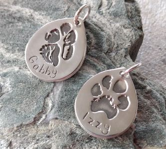 Fine silver pawprint charm. Your pets actual paw imprinted into a bespoke silver charm. Cheshire