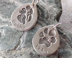 Pawprint silver charms. Fine silver pawprint pendants. Pet keepsakes. Silver pawprint charm.