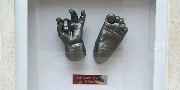 Baby Hand and foot 3D cast. Handmade and painted in a chrome paint. Poynton, Stockport, Cheshire.