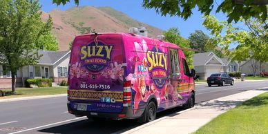 Suzy Thai Food Truck during Neighborhood Delivery Program. Utah Street with grass trees mountains
