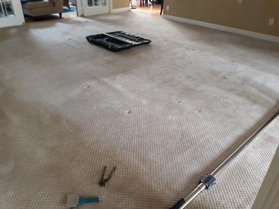 Power stretcher and tools on carpet before starting a re stretch.