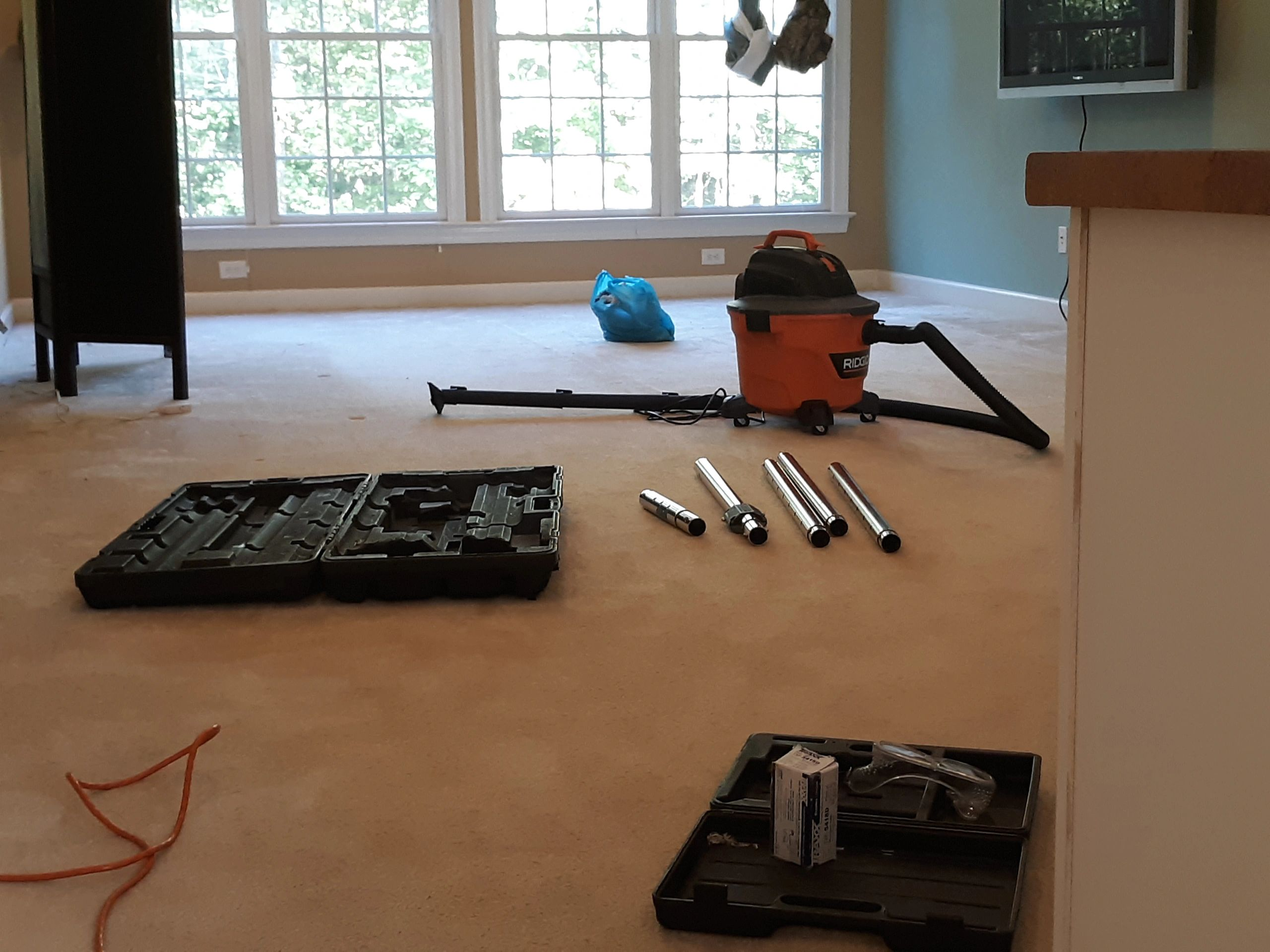 the carpet handyman doing carpet stretching in apex raleigh nc