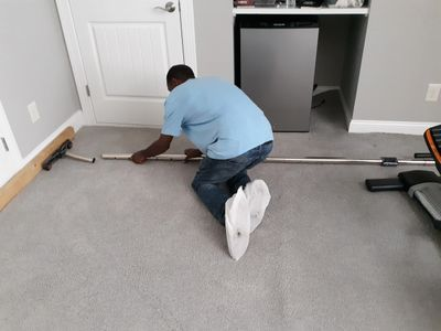 Carpet Installer stretching & repairing carpet apex cary garner durham raleigh chapel hill nc
