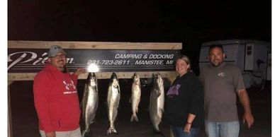 Dale and Lisa with Captain Greg and their catch.  They brought in a 30 pounder!
