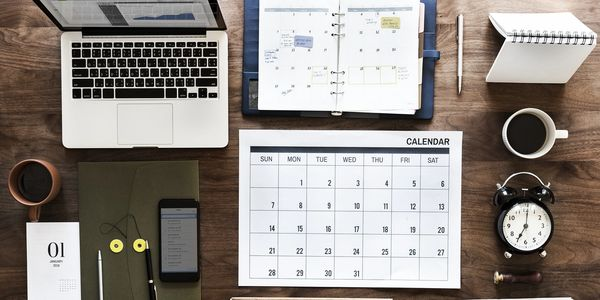 A Northwest Arkansas business desk with content calendar, marketing strategy and social media plans