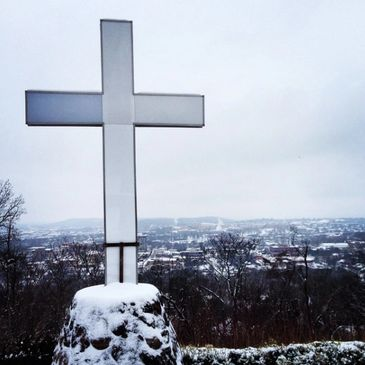 Snow covered cross on top of Mount Sequoyah over Fayetteville, Arkansas shows classic NWA brand