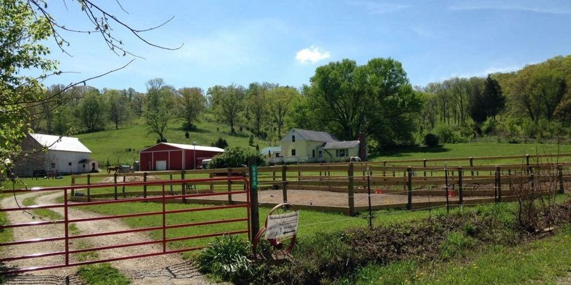 HHIA Farm Proper featuring riding arenas, barns and pasture