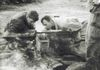 "Repairing a .50 Caliber - ""Chuck"" on the right"