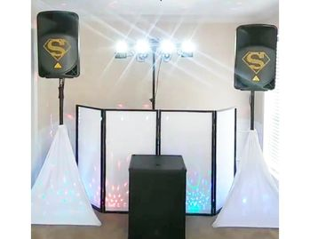 dance floor laser lights, bass cabinets and 2 loud speakers, plus the elegant all-white DJ setup.