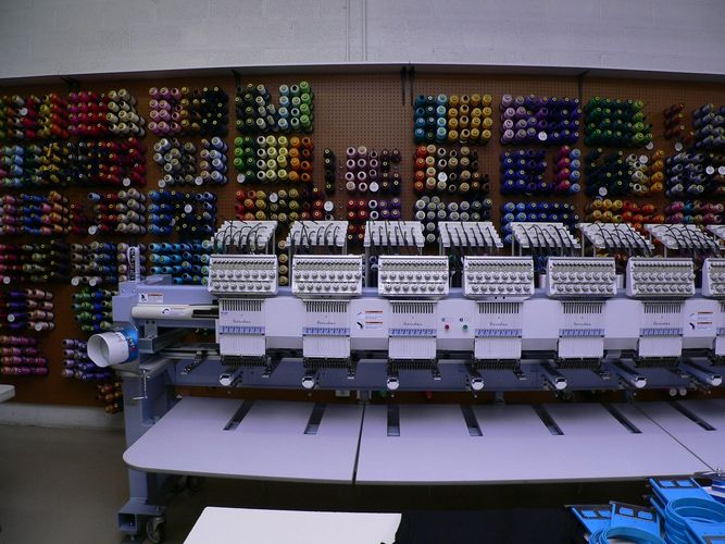 Embroidery machine and wall of thread