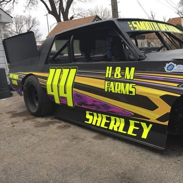 Andy Sherley's Figure 8 racecar we wrapped through our sponsorship program.  It features fluorescent yellow overlays with a matte finish overlaminate.