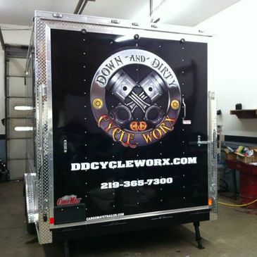 A trailer we lettered for Down & Dirty Cycle Worx.  We removed the screws in the aluminum and added full color printed wrap material and cut vinyl.  After installing the vinyl elements, we reinstalled the screws for a seamless & clean look.