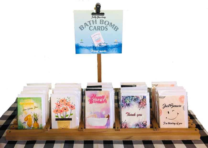 Retail display for bath bomb cards that fully dissolve and are eco friendly. Unique gift ideas