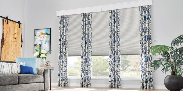 Graber crystal pleat cordless shades with decorative side panels and a wood cornice.
