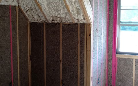 cellulose insulation in the walls with open cell foam in the roof deck