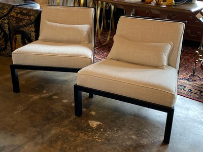 A comfortable pair mid century asian modern black slipper chairs are by Michael Taylor for Baker.