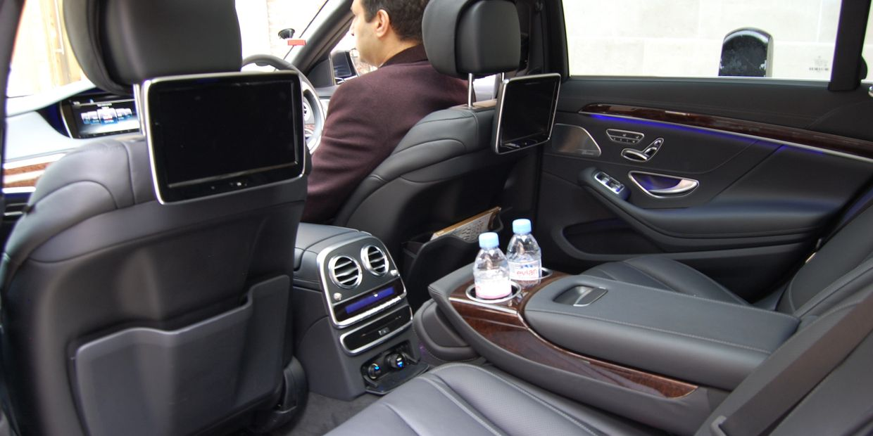 The inside of a car driven by a chauffeur in London