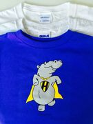 Donned in a caped, the dancing hippo transforms himself in Super Hippo.